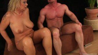 Bald guy Markus Waxenegger fucks sexy cougar Rosalyn doggy style image