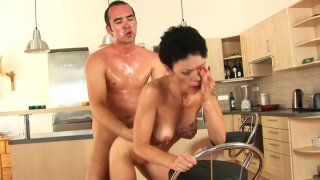 Flabby brunette MILF Inka rides Ryan's young cock on the floor image