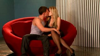 Image: Naughty blonde babe Logan in tight black dress makes out with young man and sucks his cock