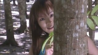 Cute and bosomy Japanese lady Yoko Matsugane walks_in woods image