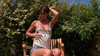 Image: Lovely brunette teen Aiden masturbates in the garden