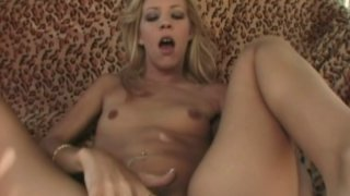 Shiny blonde woman Leah Luv sucks two dicks with buttplug in her ass image