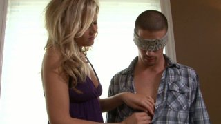 Playful Darcy Tyler blindfolds Ty Roderick and sucks his dick image