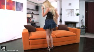 Marvelous beauty Sophie Moone poses on a cam and strips seductively image