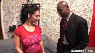 Provocative skank Bella Reese poses on a cam_and gives an outrageous blowjob right in the office image