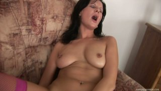 Nasty black haired MILF Naomi stuffs her cunt with vibrator image