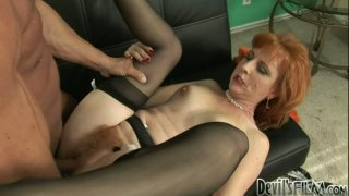 Redhead cougar Sasha Brand in black stockings gets her cunt railed on the couch image
