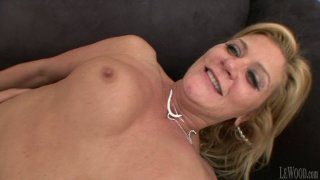 A bit plump blond hooker Ginger Lynn is fucked from_behind image