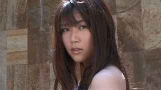 Frisky brunette Asian Mami Nagaoka takes a tap in_the swimming_pool image