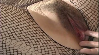 Chubby whore Sakura Kawamine all tied and helpless in bed image