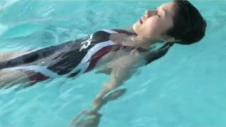 Athletic Japanese girl Mikie Hara swims in a pool like a real pro image