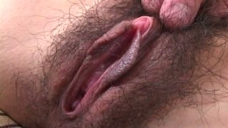 Feisty Japanese slut Chinatsu Izawa shows off her bearded clam close-up and gets_pleasured by two horny studs image