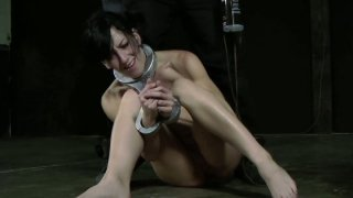 Hussy jade Elise Graves gets a hard butt plug in a hardcore BDSM video image
