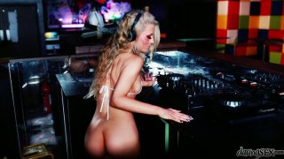Nude and Sextractive dj Michelle Moist blows cock on a dance floor image