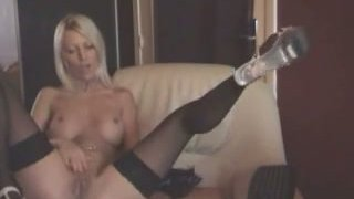 Blonde girl strips and masturbates on a cam image