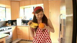 Young Japanese house wife Natsuko Tatsumi makes a fruit salad image