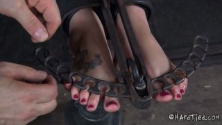 Hailey Young takes part in a hardcore BDSM video produced by Infernal Restraints image