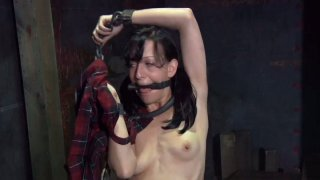 Lewd brunette hoe Elise Graves pisses on the floor all chained image