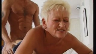 Chubby blonde granny rids young dick and fucks doggystyle image