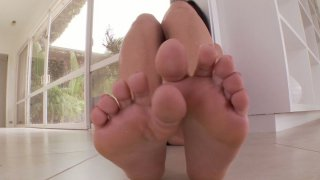 Brunette Alexa Nicole shows off her manicured feet image