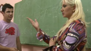 Voracious teacher Leah_Lush seduces her student and gets cunnilingus image