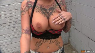 Rock and_Roll babe with tattooed body gives a head image