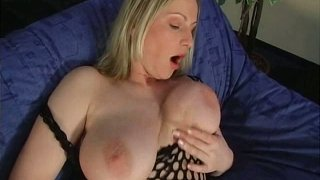 Image: Cuddly blonde milf with oversized natural tits fucks her ass with dildo