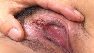 Trashy slut Yui Hanasaku gets her hairy cunt stimulated with vibrator image