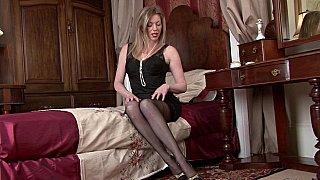 Image: Luxurious MILF posing in a vintage bedroom
