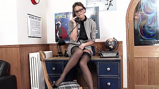 Office solo posing with a vintage-looking MILF image