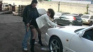 Clothed girl gets fucked on a car hood image