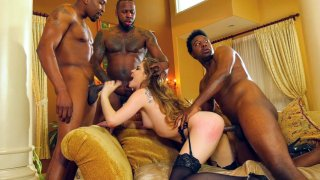Bobbi Dylan gets her mouth and pussy fucked by black cocks image