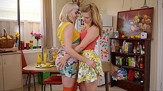 Kitchen action with two teen lezzies image