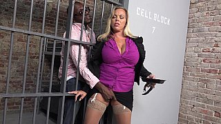 Busty MILF gets blacked in the prison image