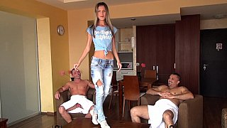 DP on sofa with 3 men image