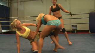 Furious chicks Andy Brown, Carla Cox and Nikky_Thorne are fighting in on ring image