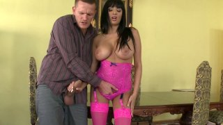 Busty hooker in pink lingerie set Anissa Kate sucking massive dick image