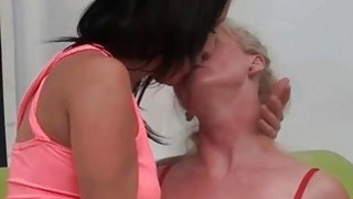 Mature dyke hoes licking boobies on the couch image