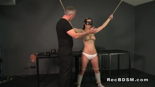 Tied up slave gets cunt vibrated and gagged image