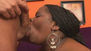 Horn-mad whore Chocolat Hottie is totally absorbed with sucking a cock image