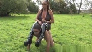 Mistress Humiliating Pathetic Sub Outdoors image