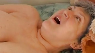 Granny masturbating hairy pussy with toy and grand image