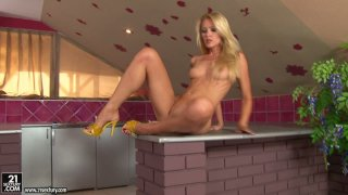 Incredible hot blond bitch Sophie Moone masturbates on the kitchen table image