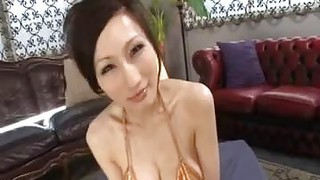 Busty Japanese MILF Giving A BJ POV image