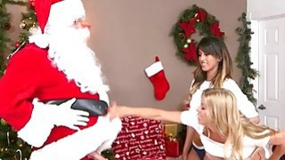 Santa caught teen and milf making out and had 3some sex image