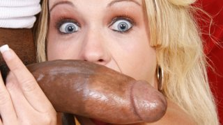 Horny blonde MILF takes big black cock in her tight pussy image