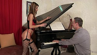 Babe in lingerie fucked by an old guy on a piano image