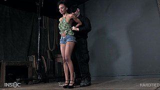 Ebony babe is tied up and ball gagged on the_floor image