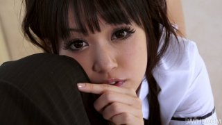 Lovely Japanese bitch Kotomi looks at him with her hot eyes image