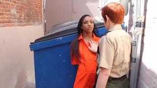 Prison Guard behind dumpster image